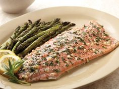 Grilling fish can be a delicious alternative to pan or oven cooking. Here is a tasty recipe for Alaska Sockeye Salmon with Herbs and Garlic. Flavor the salmon with a mixture of salt and pepper, wine, butter, garlic and herbs. Grilling Recipes, Fish Recipes, Seafood Recipes, Dinner Recipes, Cooking Recipes, Oven Cooking, Keto Recipes, Recipies, Entree Recipes