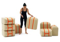 Sofa made from modules that can be carried like suitcases.