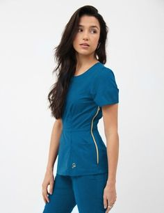 The Peplum Top in Caribbean Blue is a contemporary addition to women's medical scrub outfits. Shop Jaanuu for scrubs, lab coats and other medical apparel.