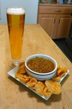 This is snacking done right! Unwind with your favorite brew and spicy pork rinds paired with a salsa of choice! #SouthernRecipeSmallBatch #PorkRinds #Beer