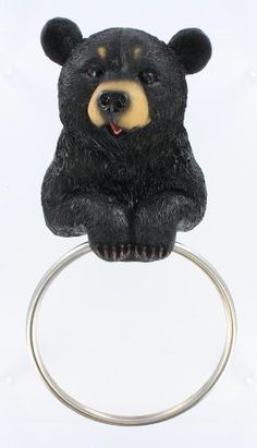 Hugo The Helper by DWK Corp.. $19.99. Black bear towel holder.. Very cute black bear holder with towel ring.Would be great in bathroom or kitchen.Very uniquely handcrafted design created to bring a special touch to your home.app14in long/ 8in wide.