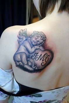 Unique Angel Tattoo Designs... I want something like this, just not with the heart