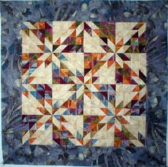Hunter's Star half-square triangle scrap quilt