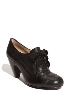 Oxfords with a heel and a ribbon bow