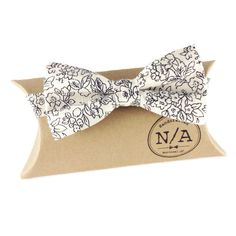 Floral bow tie, men's floral bow tie, cream and black, ivory bow tie, adjustable, pretied bow tie by NACreates on Etsy https://www.etsy.com/listing/267933947/floral-bow-tie-mens-floral-bow-tie-cream