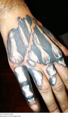 A tattoo design picture by The Power Dude: dark,evil,skull,skeleton,bone,crossbones,outlaw,hand,finger,knuckle,black,white,realistic,real,anatomical,torn,ripped,death,horror