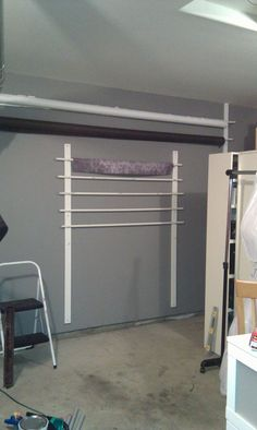 backdrop support system and storage area coming together, all supplies from Home Depot, cost under $50 to make.
