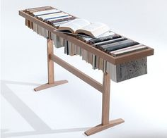 A collaboration between Italian furniture company Lema and Israeli design studio Raw Edges for IMM Cologne, The Booken is a Library, Table and Shelf in one.