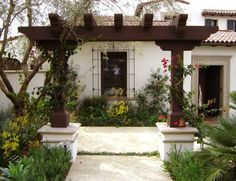 front entry front walkway pergola spanish style wrought iron