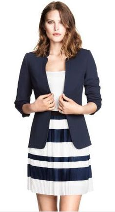 This look is confident and professional in my work place. The skirt is a bit to short for dress code. Still looks like she is ready for a meeting or job interview,