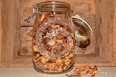 Photo about A glass Jar with dry chanterelle great taste mushroom yellow wooden background. Image of yellow, taste, glass - 109151241 Mushroom Pictures, Wooden Background, Glass Jars, Stuffed Mushrooms, Yellow, Tableware, Image, Stuff Mushrooms, Glass Pitchers