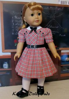 1950s School Dress   Made from a homespun coral, ivory and black plaid, this 50's inspired school dress was made to fit American Girl Doll Maryellen. It features a faux leather belt, bodice details and a white round collar smartly bedecked with a little black bow.