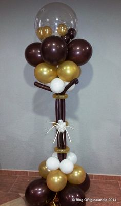 Yellow and black balloon column with gold star balloon for Balloon decoration los angeles