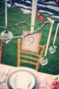 Table numbers dont always have to stand up on the table - they can also hang above the table