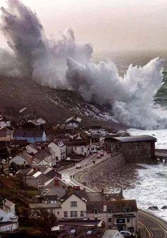 """South West England has been battered by gale force winds and massive waves. Waves in Sennen Cove, Cornwall, were photographed BREAKING OVER THE TOP OF A HILL. The Shipping Forecast rated the wave height """"phenomenal"""", the highest rating they have. No Wave, Cornwall England, England Uk, Cornwall Coast, Oxford England, Yorkshire England, Yorkshire Dales, London England, Beautiful World"""