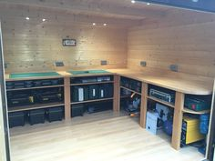 """Garden workshop complete with custom built workbench, six double brushed steel sockets and switch, spot lights, laminate flooring and plenty of storage."" - Brian Jones"