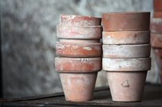 vintage-terra-cotta-garden-pots, from Etsy paint new pots with dried milk and leave in the sun to get a similar effect Repinned by www.silver-and-grey.com