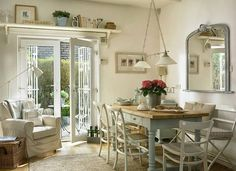 The kitchen dining area in Marie and Alan McMillen's cottage style bungalow near Holywood in County Down. French Cottage Decor, Home, Dining, Country Dining, Cottage Decor, Painted Dining Table, Dining Room Decor, Chic Dining Room, Large Dining Room