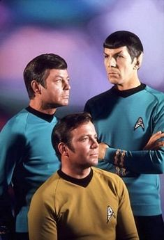 """William Shatner"" as the Star Trek Captain James T. Kirk, Chief medical officer Leonard McCoy (Deforest Kelly) and First officer Mr Spark (Leonard Nimoy). Star Trek follows the adventures of Starship USS Enterprise and it's Crew. ""Where no man has gone before."" The original Star Trek TV. Gene Roddenberry produced from 1966-1967. 1968-1969 by Paramont. TV show was on NBC and CBS."