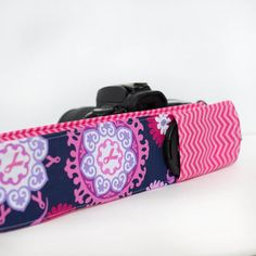 DSLR camera strap cover with lens cap pocket.  Pink by sewquiltmom, $16.00