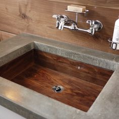 This reader gave his ugly 1960s bath a complete redo with a DIY concrete countertop and a hand-crafted sink of reclaimed walnut. | thisoldhouse.com/yourTOH