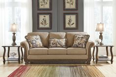 The Westerwood Living Room Collection by Signature Design features traditional style, Patina color, polyester upholstery and showood front rails, arm panels and legs. Cushions are constructed of low melt fiber wrapped over high quality foam.