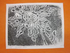 Simple white glue prints...draw the design, trace with white glue, dry over night, and print.