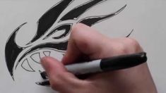 Sketching Out a Dragon Head - Turned Into a Tribal Tattoo Design