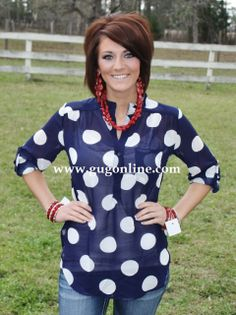Giddy Up Glamour  $32.95  Never Too Minnie Navy Dot Top - The price tag hanging off her bracelets is driving me NUTS! Just sayin.