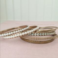 ⚡️LAST CHANCE SALE⚡️Gold Bangle Set Set of eight gold colored bangle bracelets. Some have Pearl and rhinestone embellishments. Perfect summer accessories for a classic look! In excellent condition. From a clean, pet-free, smoke-free home. Jewelry Bracelets