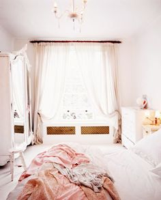 I am really liking all the light colors and fabrics used in these shabby chic rooms