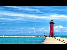 """Kenosha Lighthouse, Wisconsin, USA from Travel with Iva Jasperson  Hello everyone... The Kenosha North Pier lighthouse or Kenosha Light is a lighthouse located near Kenosha in Kenosha County, Wisconsin.  """"A typical 'Lake Michigan red tower'"""", it is a sibling to the Milwaukee Pierhead Light. This light was built in 1906 as a replacement for the old Kenosha Light.  The station was established in 1856. This pierhead light is one of a succession of lighthouses in this location, which were needed…"""
