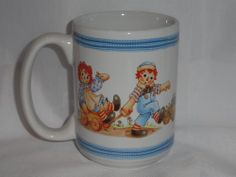 Raggedy Ann and Andy Mug Houston Harvest White Blue Trim Large Collectible Cup