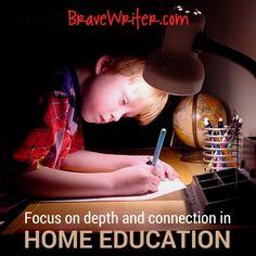 Boy writing at desk BW