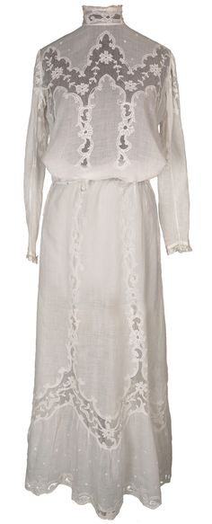 Here is a circa 1900 two piece ensemble comprised of a skirt and blouse made of very fine lawn cotton. The blouse has a lovely high neck with lace frill. It does up with 8 small mother of pearl button