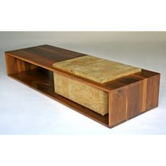nomad coffee table, with an upholstered farking seat.