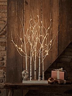 Inspired by a Midwinter forest, our bestselling Indoor Outdoor Birch Trees are now available in a cool cluster. A contemporary alternative to traditional fir trees, our pre-lit wire framed trees are wrapped in weatherproof white coating and painted to look just like silver birch. Adorned with soft white LEDS, each cluster includes five small trees with branches that are entirely posable, all sat upon a simple white base.