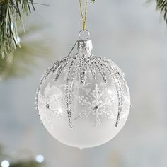 Handblown and hand-painted in the Czech Republic, our snowflake ornament shimmers with silvery glitter. A Pier 1 exclusive.