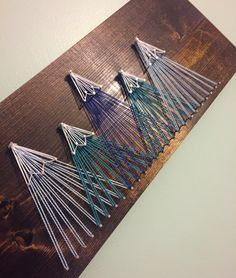 Mountain string art on wooden board