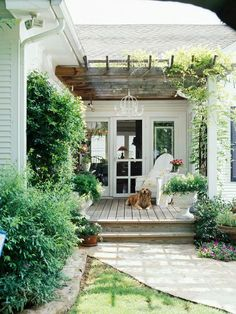 Pergola porch with climbing vines and a raised teak deck.