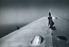 The Graf Zeppelin being repaired in mid-air over the South Atlantic enroute to Rio de Janeiro. Description from urbanfragment.wordpress.com. I searched for this on bing.com/images