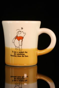 """Disney Winnie the Pooh 2 Tone Mug.. """"It was a perfect day for wondering. Humming down the lane"""" Disney Winnie the Pooh 2 Tone Ceramic Mug stands 3 1/2"""" tall and is 3"""" wide at the brim."""