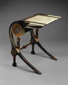 Desk  Carlo Bugatti  (Italian, Milan 1855–1940 Molsheim)  Date: ca. 1902 Medium: Walnut, copper, pewter, vellum Dimensions: H. 29-1/2, W. 23-2/3, D. 22-1/2 inches (74.9 x 60.1 x 57.2 cm.) Classification: Furniture Credit Line: Rogers Fund, 1970 Accession Number: 1970.181.3
