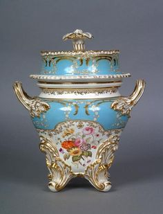 Coalport Ice pails were sold as part of dinner and dessert services. They consisted of the main pail, an inside liner and a cover. This elaborate example with hand-painted floral panels dates from c1860.