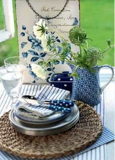 pretty blues and whites with pewter plates...I have a 12 piece set of pewter plates...beautiful
