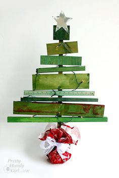 scrap wood nailed or screwed to a post and dyed with rit dye.  A large one would be cute for outside. Add lights and ornaments