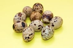 a lot of quail eggs on yellow background