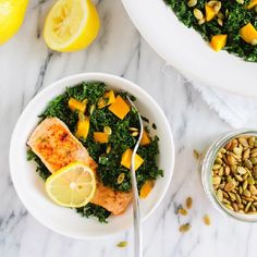 This kale salad is massaged with lemon and olive oil, then dressed with sweet mangoes and roasted pepita seeds.
