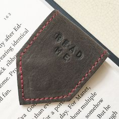 The grey leather bookmark has made a comeback, different shade of grey and paired with a burgundy wine suede lining. Upcycled leathers, limited edition ♻