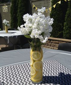 Lemon centerpiece with white stock. Very affordable